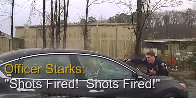 Officer Charles Starks can be seen reporting shots fired while on the car's hood during the Feb. 22 incident.