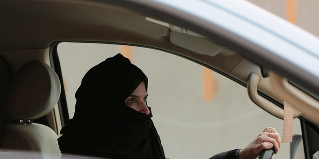 In this March 29, 2014 file photo, Aziza al-Yousef drives a car on a highway in Riyadh, Saudi Arabia, as part of a campaign to defy Saudi Arabia's then ban on women driving.  (AP Photo/Hasan Jamali, File)