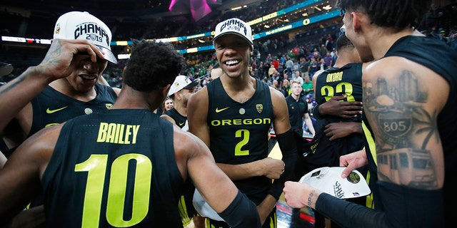 Oregon players, including Louis King (2) and Victor Bailey Jr., celebrate after defeating Washington 68-48 in an NCAA college basketball game in the final of the Pac-12 men's tournament Saturday, March 16, 2019, in Las Vegas.