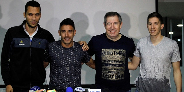 Soccer players of Brazil's Chapecoense (L to R) Helio Neto, Alan Ruschel and Jakson Follman and survivor journalist Rafael Henzel, survivors of the team's plane crash, pose during a news conference upon their arrival in Medellin, Colombia, May 8, 2017. Picture taken May 8, 2017. REUTERS/Fredy Builes TPX IMAGES OF THE DAY - RC12FDFC9B60