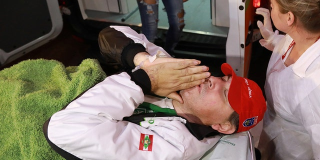 Brazilian radio journalist Rafael Henzel lies on a stretcher as he arrives at the hospital after he survived a plane crash with Brazilian soccer team Chapecoense aboard, in Chapeco, Brazil December 13, 2016. REUTERS/Diego Vara - RC1F46512B10