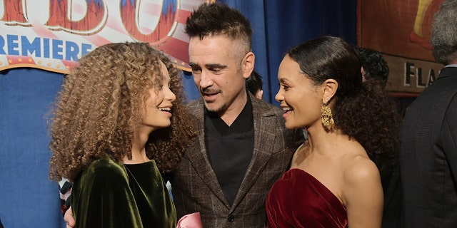 "(L-R) Actors Nico Parker, Colin Farrell and Thandie Newton attend the World Premiere of Disney's ""Dumbo"" at the El Capitan Theatre on March 11, 2019, in Los Angeles, Calif."