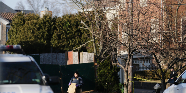 """Police work near the scene where an alleged leader of the Gambino crime family was shot and killed in the Staten Island borough of New York, Thursday, March 14, 2019. Francesco """"Franky Boy"""" Cali, 53, was found with multiple gunshot wounds to his body at his home Wednesday night. (AP Photo/Seth Wenig)"""