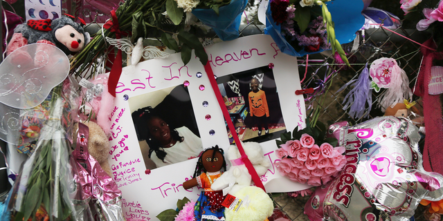Dozens Of Tributes Are Seen At A Large Memorial To Trinity Love Jones The 9