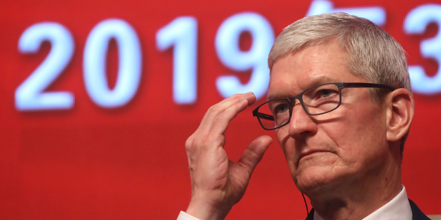 Apple CEO Tim Cook reacts during a Economic Summit hold for a China Development Forum in Beijing, China, Saturday, Mar 23, 2019. Cook says he's intensely bullish about a tellurian economy formed on a volume of creation being carried out, and he's propelling China to continue to open up. (AP Photo/Ng Han Guan)
