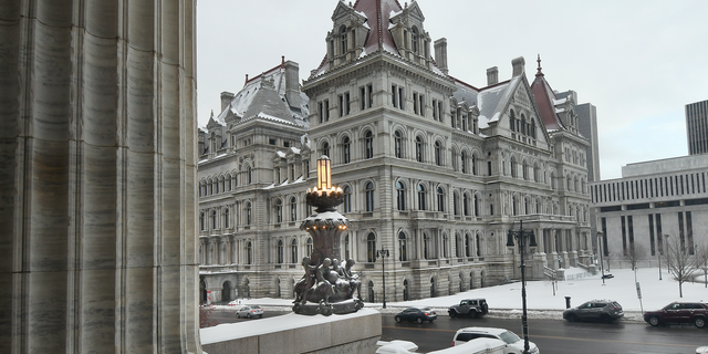 FILE - This Feb. 13, 2019 file photo shows the New York state Capitol building as seen from the steps of the New York state Education Department Building, in Albany, N.Y. Though leaders such as Democratic Gov. Andrew Cuomo insist New York has a tough law on sexual harassment, with more changes proposed in the current legislative session, allegations that roiled a 20-employee office in Glens Falls underscore a familiar criticism: Aggressive policies at state agencies aren't of much use if managers don't take action. (AP Photo/Hans Pennink, File)