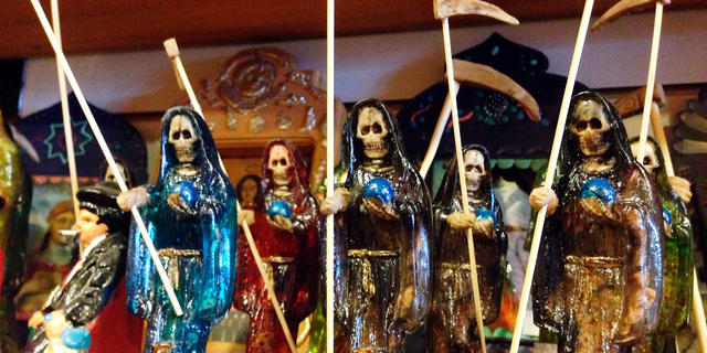 FILE - In this Feb. 13, 2013 file photo, statues of La Santa Muerte, an underworld saint most recently associated with the violent drug trade in Mexico, are shown at the Masks y Mas art store in Albuquerque, N.M. Santa Fe Archbishop John Wester recently told The Associated Press he believes some Catholics may be fooled into venerating Santa Muerte even though the focus on death runs counter to the church's teachings and she's not an official Catholic saint. (AP Photo/Russell Contreras, File)