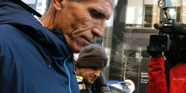 "William ""Rick"" Singer founder of the Edge College & Career Network, departs federal court in Boston on Tuesday, March 12, 2019, after he pleaded guilty to charges in a nationwide college admissions bribery scandal. (AP)"