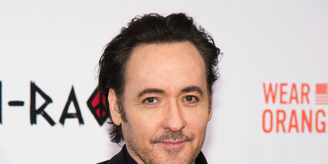 John Cusack filmed an altercation with a police officer at a protest in Chicago.