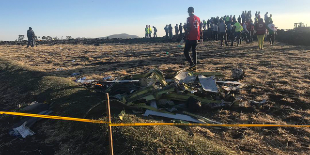 The Ethiopian Airlines flight crashed shortly after takeoff from Ethiopia's capital on Sunday morning, killing all 157 on board, authorities said, as grieving families rushed to airports in Addis Ababa and the destination, Nairobi. (AP Photo/Yidnek Kirubel)