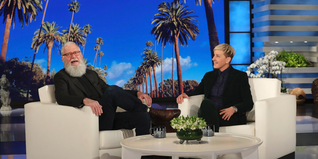"In this March 7, 2019 photo released by Warner Bros., David Letterman appears with host Ellen DeGeneres during a taping of ""The Ellen DeGeneres Show"" in Los Angeles."