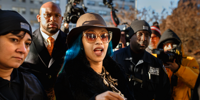 Rapper Cardi B, center, arrives at Queens County Criminal Court in New York on charges related to a brawl at a New York strip club, Dec. 7, 2018. (Associated Press)