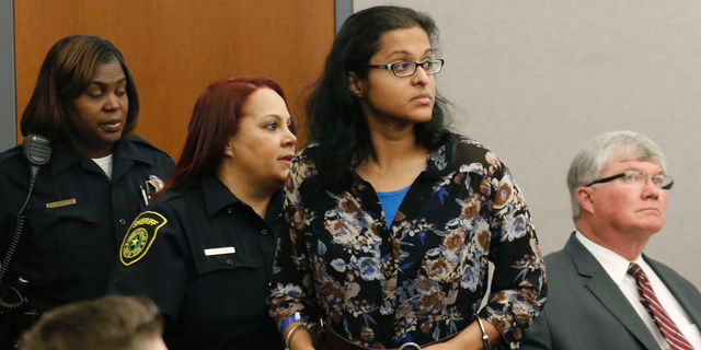 FILE - In this Nov. 29, 2017 file photo Sini Mathews, mother of Sherin Mathews, appears in court at the Henry Wade Juvenile Justice Building in Dallas. The Dallas County District Attorney's Office said in a statement Friday, March 1, 2019, that its dropping the child-abandonment charge against 36-year-old Mathews for lack of evidence for the killing of her 3-year-old daughter. Her husband remains jailed and accused of killing the girl, Sherin Mathews.(David Woo/The Dallas Morning News via AP, Pool File)
