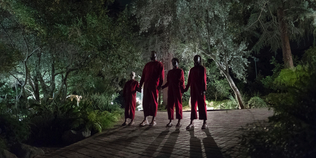 """This image released by Universal Pictures shows Evan Alex, from left, Winston Duke, Shahadi Wright Joseph and Lupita Nyong'o in a scene from """"Us,"""" written, produced and directed by Jordan Peele."""