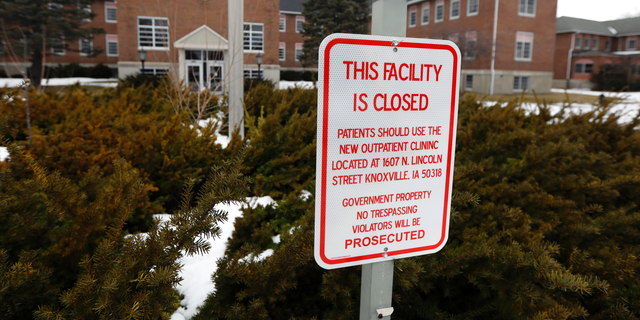 A facility closed sign hangs in front of the main building on the Veterans Affairs campus, Tuesday, March 12, 2019, in Knoxville, Iowa. Since the Veterans Affairs moved out of the sprawling campus on the edge of Knoxville a decade ago, local leaders have become increasingly anxious about the ghost town on the edge of their living community. (AP Photo/Charlie Neibergall)
