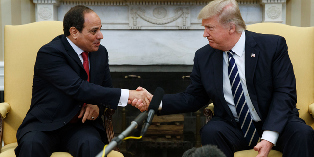 FILE - In this April 3, 2017 file photo, President Donald Trump shakes hands with Egyptian President Abdel Fattah el-Sisi in the Oval Office of the White House in Washington. Trump will meet with El-Sissi next month at the White House. (AP Photo/Evan Vucci)