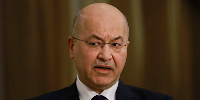 """Iraq's President Barham Salih speaks during an interview with The Associated Press in Baghdad, Iraq, Friday, March 29, 2019. Salih says he does not see any """"serious"""" opposition when it comes to the presence of American forces in Iraq as long as they are there for the specific mission of assisting in the fight against the Islamic State group. (AP Photo/Khalid Mohammed)"""