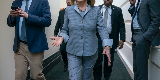 House Speaker Nancy Pelosi, D-Calif., walks to a Democratic Caucus meeting at the Capitol in Washington, Tuesday, March 26, 2019. (AP Photo/J. Scott Applewhite)