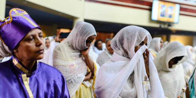 Members of the Ethiopian community taking part in a special prayer for the victims of the Ethiopian Airlines flight ET302 crash, at the Ethiopian Orthodox Tewahedo Church of Canada Saint Mary Cathedral in Toronto, on Sunday. (Christopher Katsarov/The Canadian Press via AP)