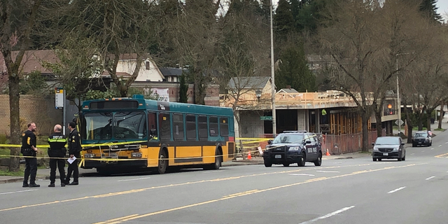 REMOVES SPECIFIC NUMBER OF PEOPLE WHO WERE SHOT, AS STORY DETAILS CONTINUE TO DEVELOP - Investigators work at the scene of a shooting in Seattle on Wednesday, March 27, 2019. (AP Photo/Gene Johnson)