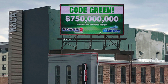 A billboard promotes an estimated $750 million Powerball jackpot in downtown Des Moines, Iowa, Wednesday, March 27.2019. (AP Photo/Scott McFetridge)