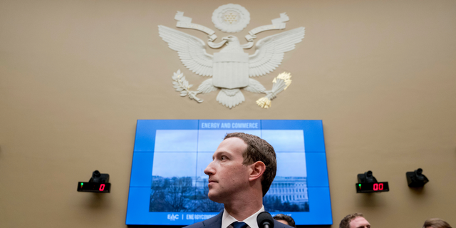 Facebook CEO Mark Zuckerberg arrives to testify before a House Energy and Commerce hearing on Capitol Hill in Washington. (AP Photo/Andrew Harnik, File)