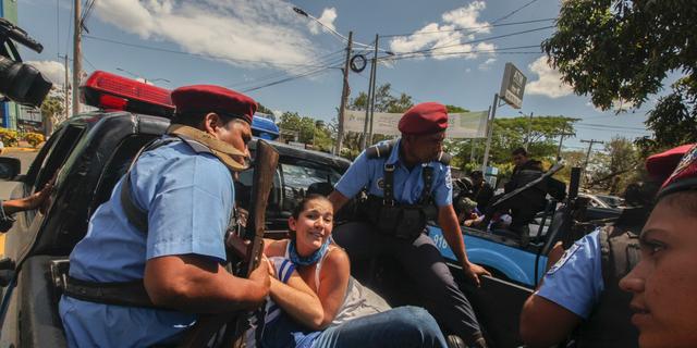 Police detain protesters in Managua, Nicaragua, on Saturday. (AP Photo/Alfredo Zuniga)