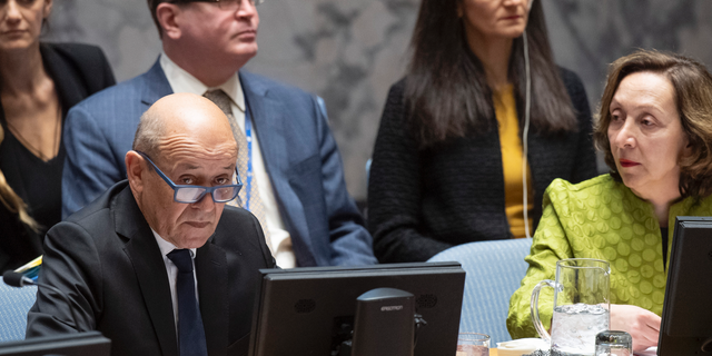 """Jean-Yves Le Drian, United Nations Security Council president, speaks at the UN headquarters about threats to international peace and security caused by terrorist acts, Thursday, March 28, 2019. The U.N. Security Council has unanimously adopted a resolution aimed at strengthening global efforts to combat the numerous and new ways that terrorist groups raise funds to finance their operations. The French-drafted resolution approved Thursday orders all countries to ensure that their domestic laws are sufficient to prosecute and penalize those responsible for directly or indirectly financing """"terrorist organizations or individual terrorists for any purpose."""" At right is Hasmik Egian, Director of the Security Council Affairs Division of the Department of Political and Peacebuilding Affairs. (Eskinder Debebe/United Nations via AP)"""