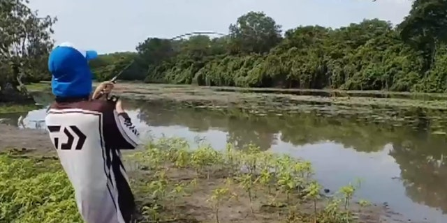 Daniel, seen here, hooked the barramundi only seconds before the crocodile reared its head.