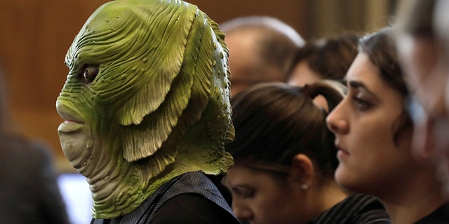 A Greenpeace USA activist attends a Senate Energy and Natural Resources Committee nomination hearing for former energy lobbyist David Bernhardt to be Interior secretary, on Capitol Hill.