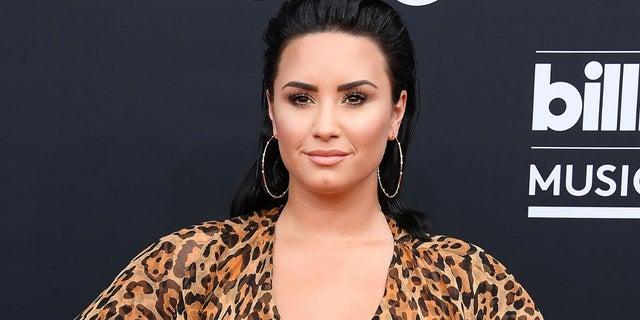 Demi Lovato jokes that she has 'PTSD' from her Disney days.