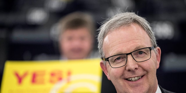 Axel Voss, Member of the European Parliament and rapporteur of the copyright bill, poses for the media at the European Parliament in Strasbourg, France, Tuesday March 26, 2019. The European Parliament is furiously debating the pros and cons of a landmark copyright bill one last time before the legislature will vote on it later. (AP Photo/Jean-Francois Badias)