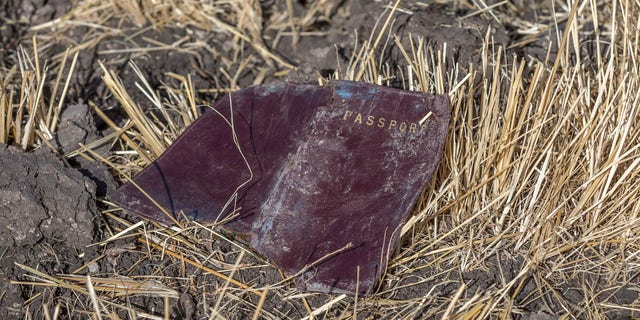 A passenger passport lies on the ground at the scene of an Ethiopian Airlines flight crash near Bishoftu, or Debre Zeit, south of Addis Ababa, Ethiopia, Monday, March 11, 2019.