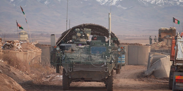A Stryker armored combat vehicle leaving on a mission from Forward Operating Base Wolverine in December 2009 near Qalat, Afghanistan. Mullah Omar, former leader of the Taliban, reportedly was living near the base for years before his death.