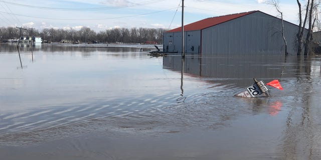 A road sign and building sitting in water left behind after the Missouri River rose to record heights, flooding a huge swath of land in the city Plattsmouth, Nebraska. (Fox News)