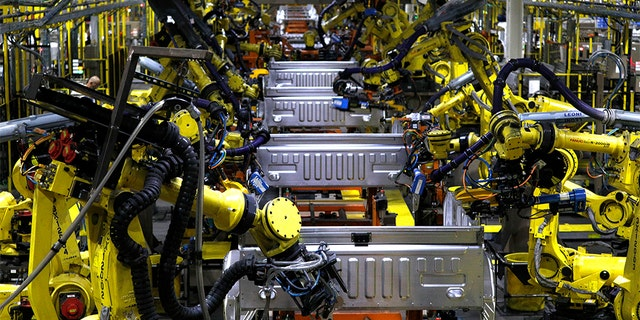 Ford F150 trucks go through robots on the assembly line at the Ford Dearborn Truck Plant on September 27, 2018 in Dearborn, Michigan. The Ford Rouge Plant is celebrating 100 years as America's longest continuously operating auto plant. (Photo by Bill Pugliano/Getty Images)