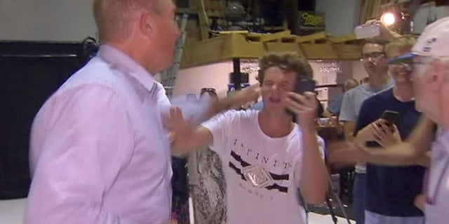 Sen. Fraser Anning was seen swiping at the teenager who broke an egg on his head on Saturday, March 16, 2019.<br>