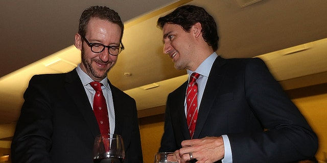Justin Trudeau speaks to his former adviser Gerald Butts back in 2015. At one point Butts was considered the most powerful person in the Prime Minister's Office, but he abruptly resigned last month.