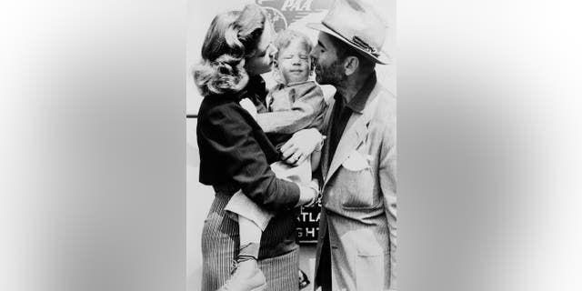Humphrey Bogart And Lauren Bacall with their son. — Getty