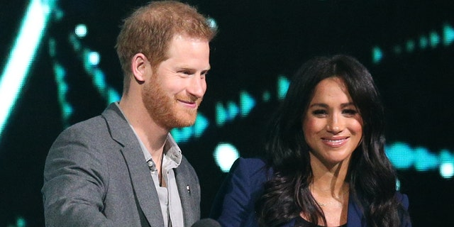 The Duke of Sussex and the Duchess of Sussex during his visit to WE Day UK at the SSE Arena in Wembley, London.