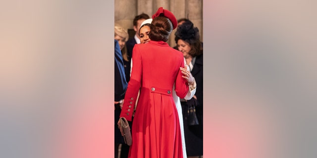 Britain's Meghan, Duchess of Sussex (L) and Britain's Catherine, Duchess of Cambridge, (R) greet each other as they attend the Commonwealth Day service at Westminster Abbey in London on March 11, 2019. — Getty