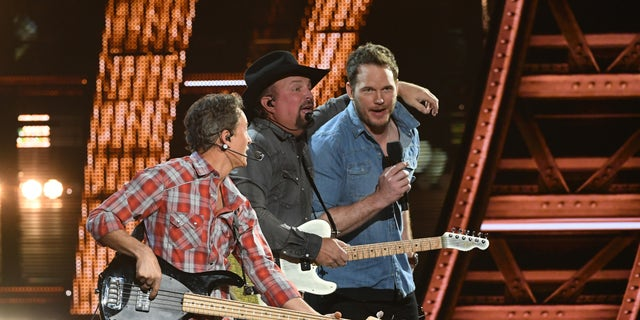 Garth Brooks and Chris Pratt perform on theatre during a 2019 iHeartRadio Music Awards that broadcasted live on FOX from a Microsoft Theater in Los Angeles on Thursday.