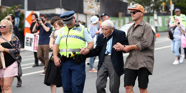 John Sato, 95, one of only two Japanese soldiers in the New Zealand army in World War II took two Howick buses to join the march against racism at Aotea Square on March 24, 2019 in Auckland, New Zealand.