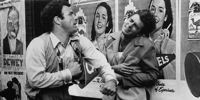 """James Caan knocks out Gianni Russo in a scene from the film """"The Godfather,"""" 1972."""