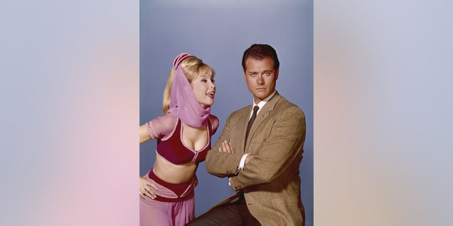 Barbara Eden as Jeannie and Larry Hagman as Major Nelson.