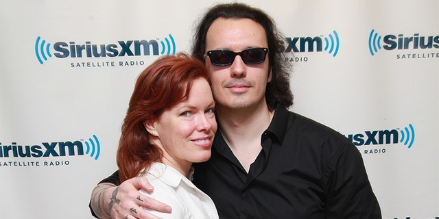 """Lori Davis and husband author Damien Echols of the West Memphis Three visit """"The Opie & Anthony Show"""" at SiriusXM Studio on Sept. 19, 2012 in New York City."""