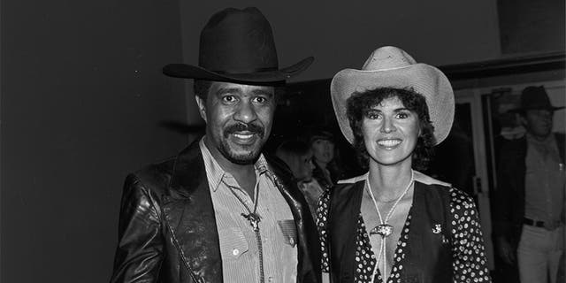 Richard Pryor and his then-future wife, Jennifer Lee, on May 19, 1979, during a annual SHARE party, hold during a Hollywood Palladium, Calif. — Getty