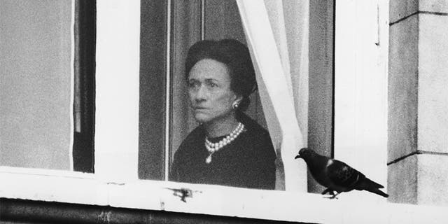 The Duchess of Windsor (1896 - 1986) watches the start of the Trooping the Colour ceremony from a first-floor window of Buckingham Palace, June 3, 1972. A one minute silence was observed for the Duke of Windsor, who had died in Paris the week before.