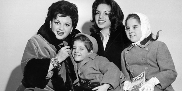 Judy Garland pictured in New York on arrival with her family, from London, en route to Miami where she will earn an all-time record salary of $10,000 for a one night stand. Mrs. Garland, wife of producer Sid Luft, arrived with her three children Liza, 14; Lorna, 8; and Joey, 5. Undated.
