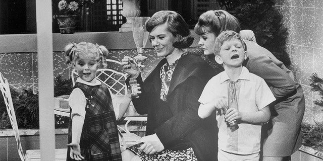 "Diane Brewster (second from left) tries to make friends with Anissa Jones, Kathy Garver, and Johnnie Whitaker (left to right) in a scene from the TV series, ""Family Affair."" 1967."